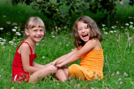 two young girls on the grass Stock Photo