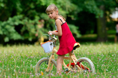Young girl on the bicycle