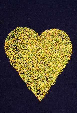 jesus love: heart made of palm tree fruits part of a Corpus Christi celebration flower carpet