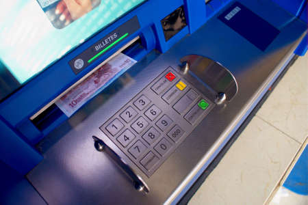 dispense: getting euro paper money at a blue cash dispenser