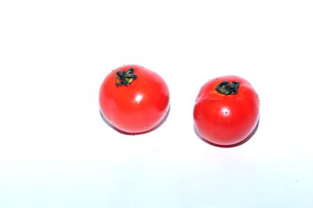 Tomato isolated on a white background Stock Photo