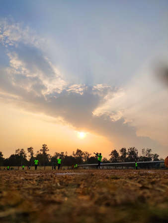 College students during practice session of cricket in morning glory Фото со стока