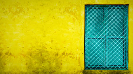 yellow wall with copy space and colorful window in India Banco de Imagens