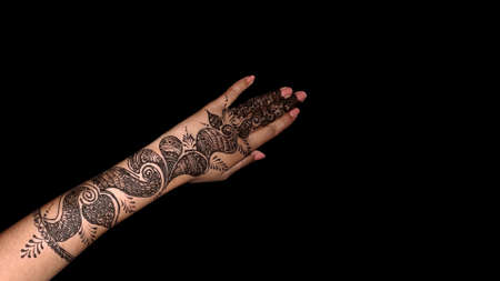 traditional Henna design on female hand specially in marriage on bride hand as makeup Indian culture