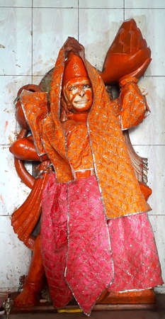 Hindu God 'Hanuman' idol in a temple with traditional cloths and vermilion or 'sindoor'