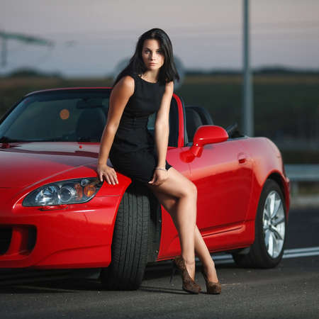 beauty portrait of a sexy woman on the street background with car