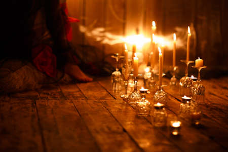 burning candles on glasses in the room