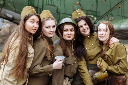 Lugansk, Ukraine - March 18, 2017: Pretty young girls in military uniform Editorial
