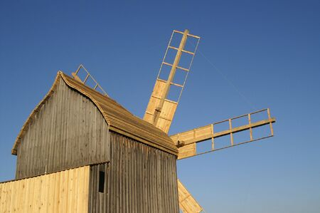Wooden windmill against the sky