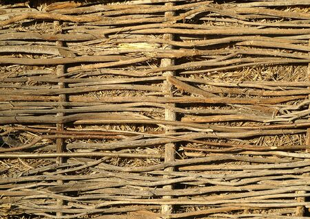 poling: Rural texture. Wicker fence Stock Photo