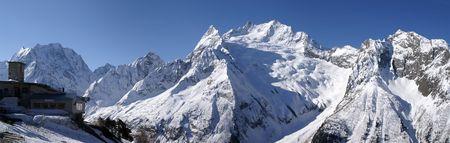 Panorama Caucasus Mountains. Dombaj. Ski resort photo