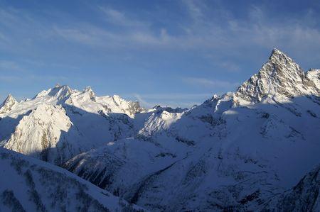 The last rays of the sun settled on the mountain peak photo