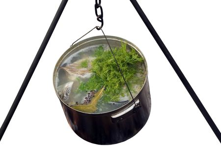 smut: Isolated cooking pot with fish soup