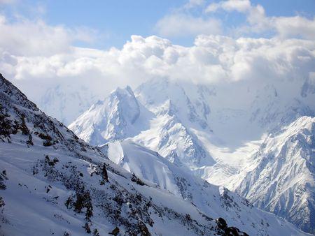 Mountains in clouds. Caucasus. Elbrus region. Gorge Irik-Chat. Stock Photo