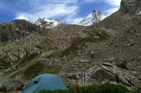 rockslide: Tent in mountains. Caucasus. Elbrus region. Gorge Adyl-Su.