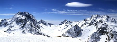 Panorama Caucasus Mountains. Dombaj. View from the ski resort. photo