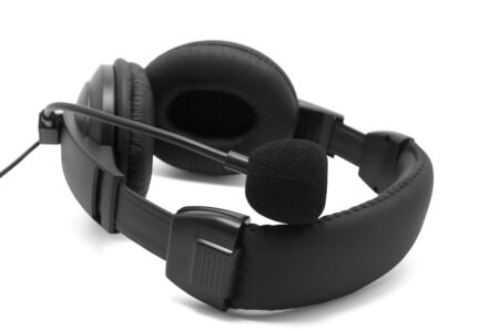 Black headphones with microphone on white background photo
