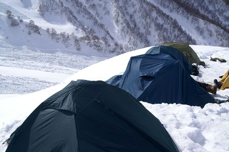 Camp in snow mountains. Caucasus. Dombay. photo