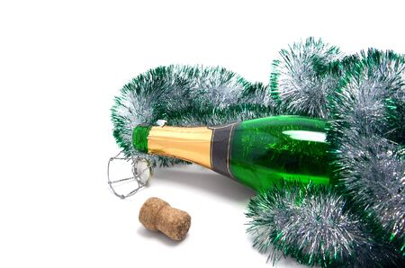Empty bottle of champagne and Christmas tinsel on white background. Stock Photo - 6121775