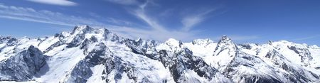 Panorama Caucasus Mountains. Dombay. View from the ski resort.