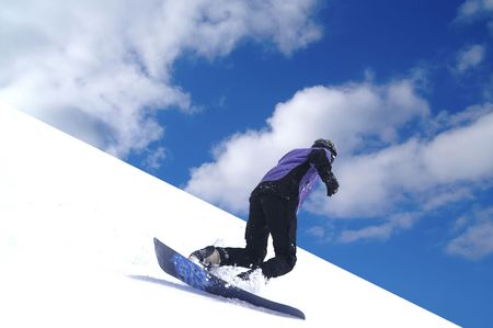 Snowboarder riding on ski slope photo