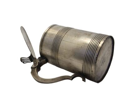 Old metal mug on isolated white background photo