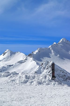 Snowboard against the snowy mountains. Caucasus. Elbrus Stock Photo - 6739108