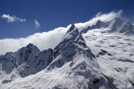 cocaine: Caucasus Mountains in cloud. Dombay. Peak Ine. Stock Photo
