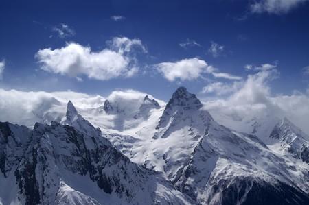 dombai: Mountains in cloud. Caucasus. Dombai. Belalakaya.