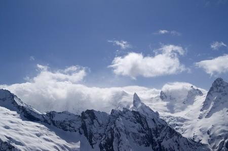 dombai: Mountains in cloud. Caucasus. Dombai.