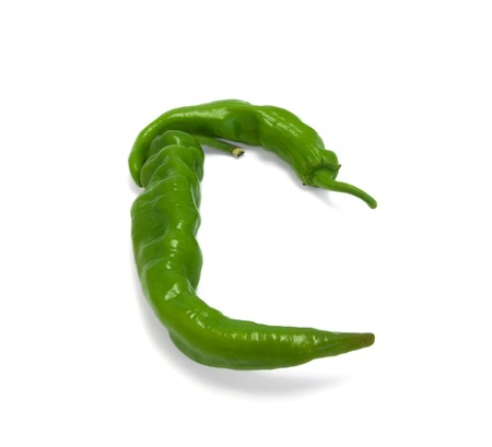 Letter C composed of green peppers on white background Stock Photo - 7858479