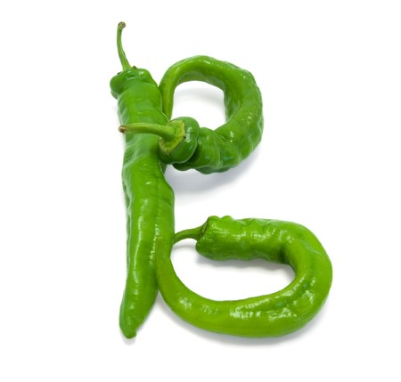 Letter B composed of green peppers on white background photo