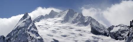 cocaine: Panorama Caucasus Mountains. Dombay. Peak Ine. Stock Photo