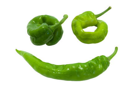Green peper in smile. Isolated on white background. photo