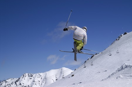 freestyle: Freestyle skiing. Ski resort Dombay. Caucasus Mountains.