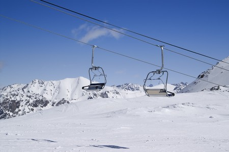 Chair lift at ski resort. Dombay, Caucasus Mountains. Stock Photo - 8217558