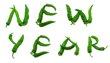 New year text composed of green peppers. Isolated on white background. photo