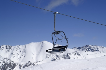 Chairlift, close-up. Ski resort Dombay. Caucasus Mountains. Stock Photo - 8405420
