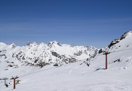 Chair-lift at ski resort. Caucasus, Dombay. Stock Photo - 8405422