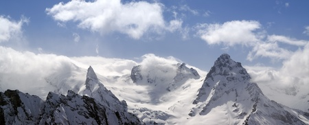 Panorama Mountains in cloud. Caucasus, Dombay. photo