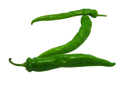 Letter Z composed of green peppers on white background photo