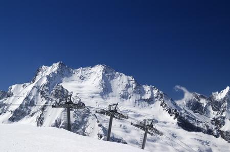 Ropeway at ski resort Dombay. Caucasus Mountains Stock Photo - 8660794