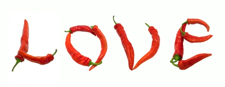 Love text composed of chili peppers. Isolated on white background. photo
