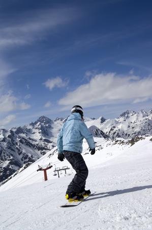 Snowboarder on ski slope. Ski resort Dombay, Caucasus Mountains. Stock Photo - 8709208