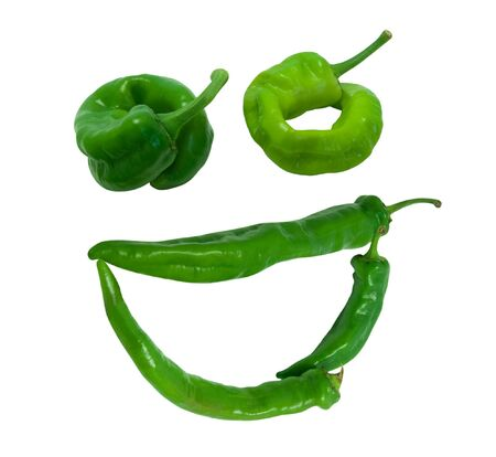 Smile grin composed of green peppers. Isolated on white background. photo