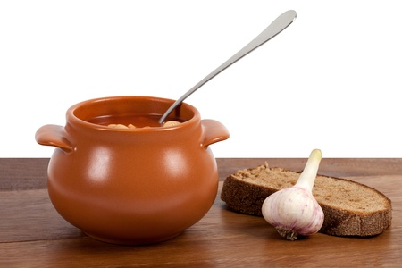 clay pot: Borsch in clay pot on wooden table Stock Photo