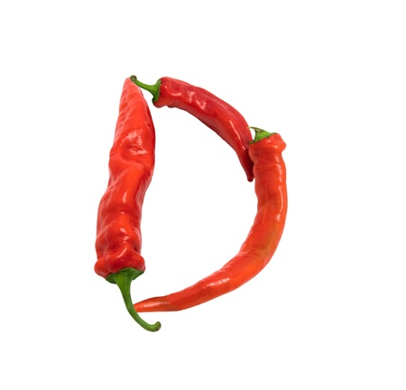 Letter D composed of chili peppers. Isolated on white background. photo