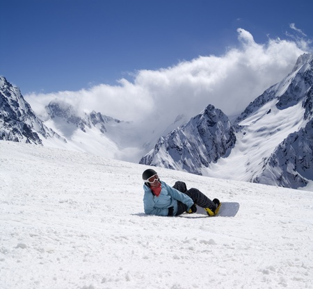 snow capped: Snowboarder on ski slope. Ski resort Dombay, Caucasus Mountains.
