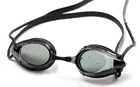 Goggles for swimming with water drops on white background