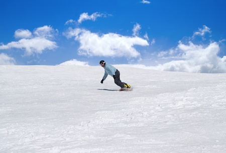 Snowboarder against blue sky photo
